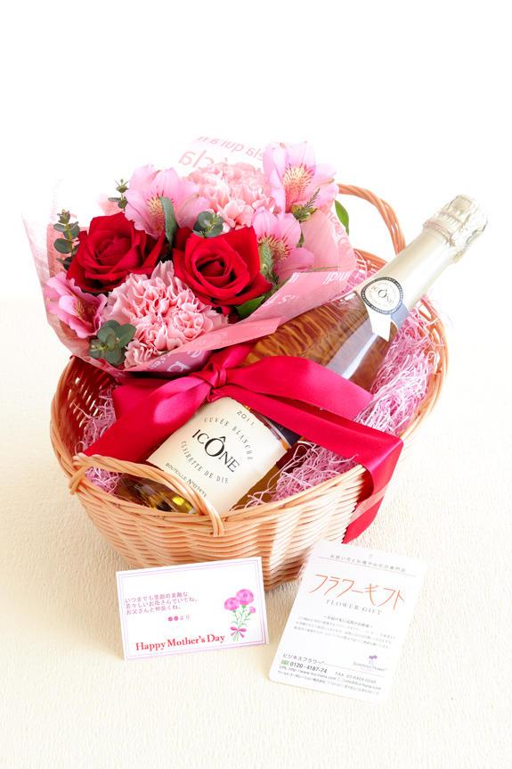 <p>バスケット入りのスパークリングワインとアレンジメントフラワーのフラワーギフト商品です。母の日のギフト、贈り物、プレゼントとしてオススメです。</p>
