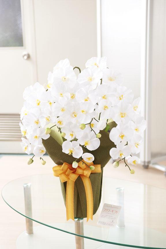 <p>造花アート・アレンジメント エレガント胡蝶蘭Wには、ビジネスフラワー®オリジナルの品質保証フラワーギフトタグがついています。</p>